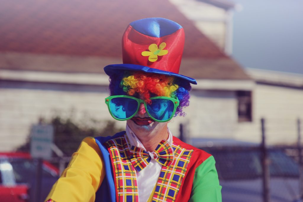 shallow focus photography of human wearing clowns costume