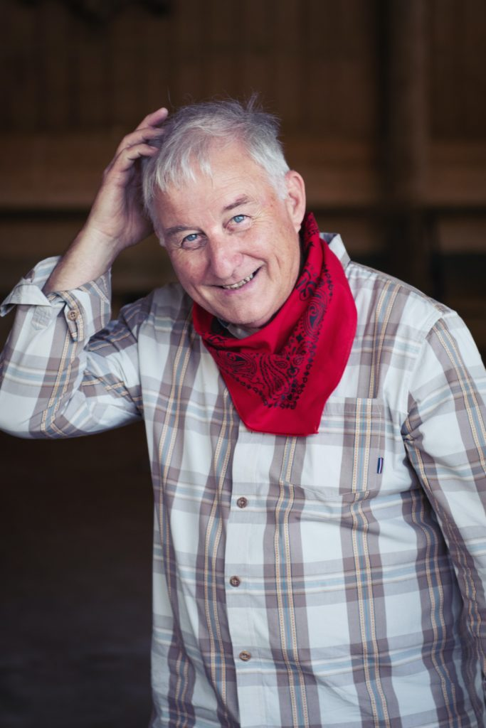 man in white and black plaid dress shirt wearing red scarf